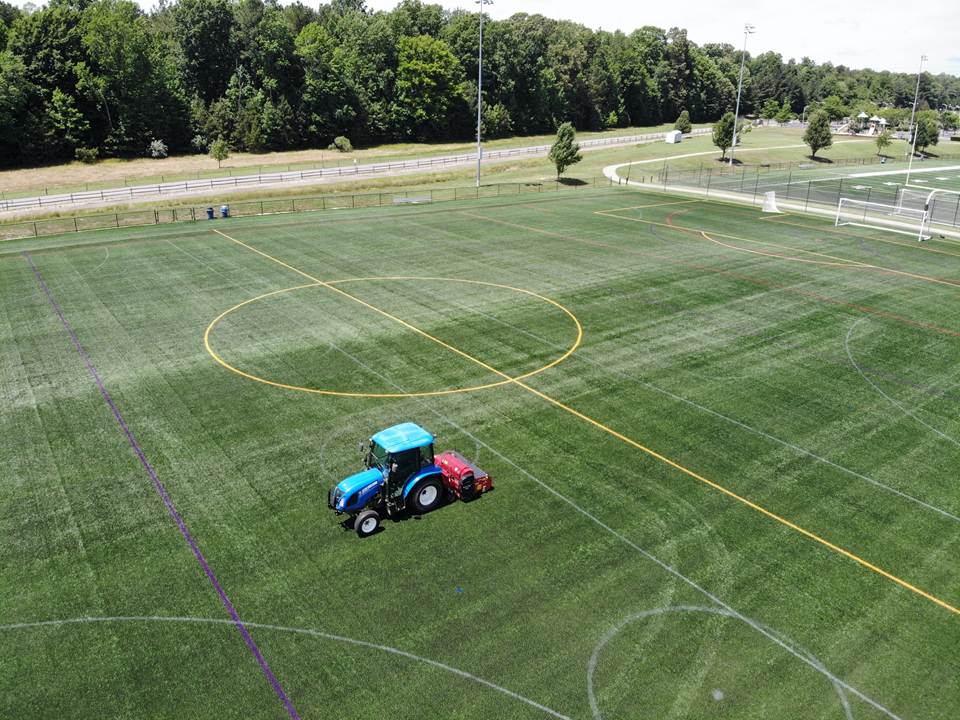 Artificial Turf maintenance being performed