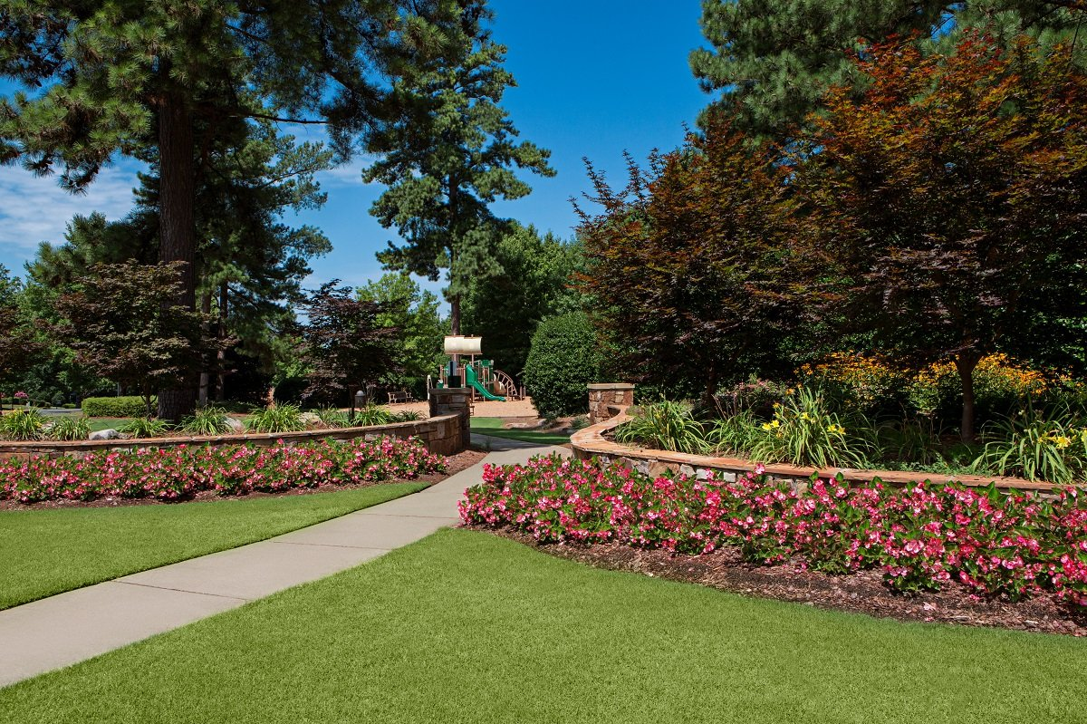 HOA property landscape with flowers and walkway