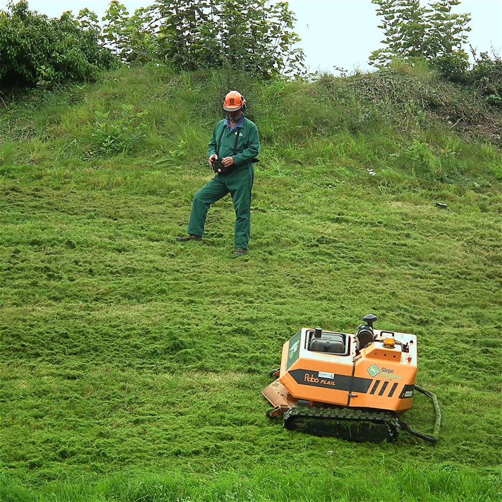 Remote controlled lawn mower used on a steep slope