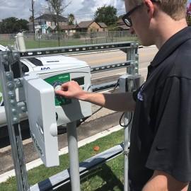 Irrigation technician adjusting a smart controller