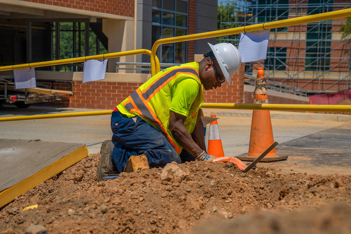 commercial landscaping company repairs broken irrigation line