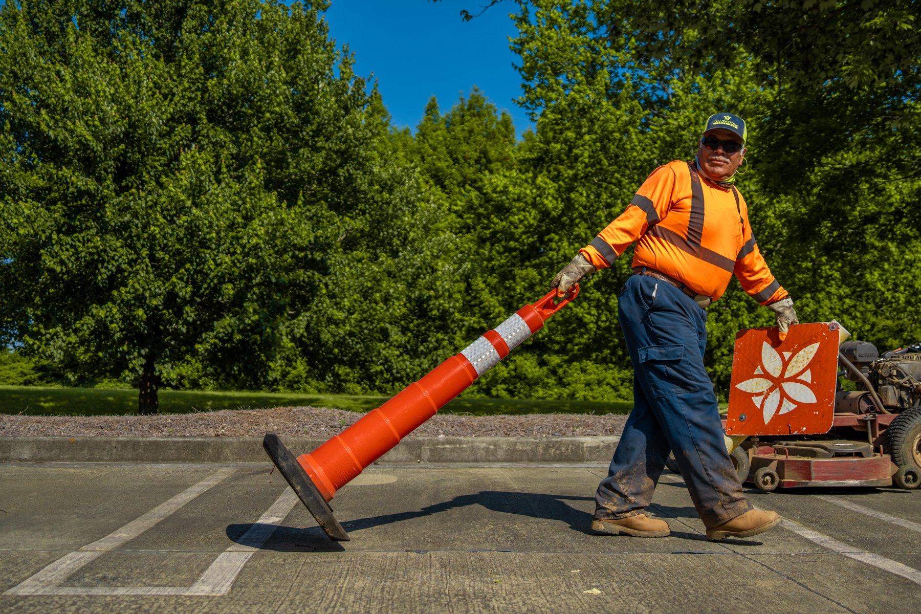 Landscape crew placing safety cones