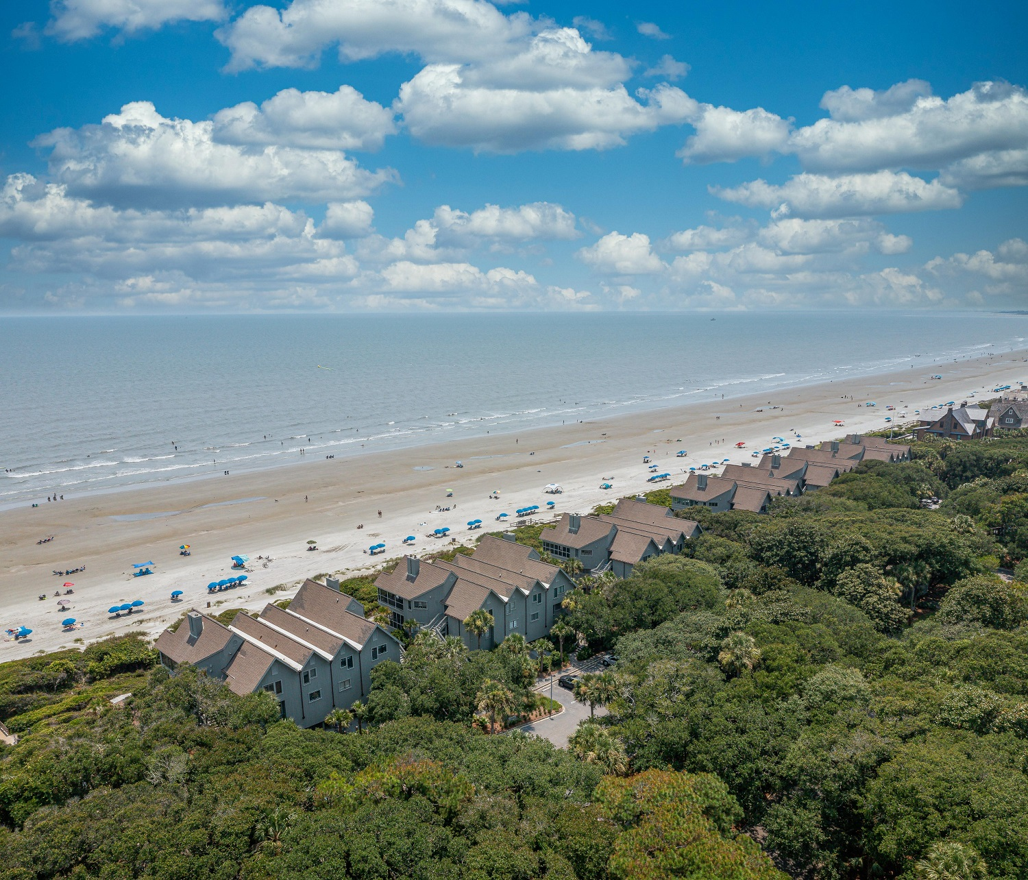 Aerial view of beach, landscaping, and homes at Mariner's Watch