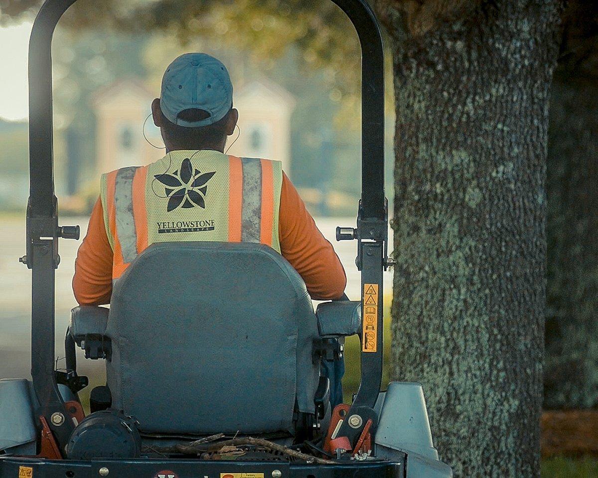 Yellowstone landscape employee working at community association landscape