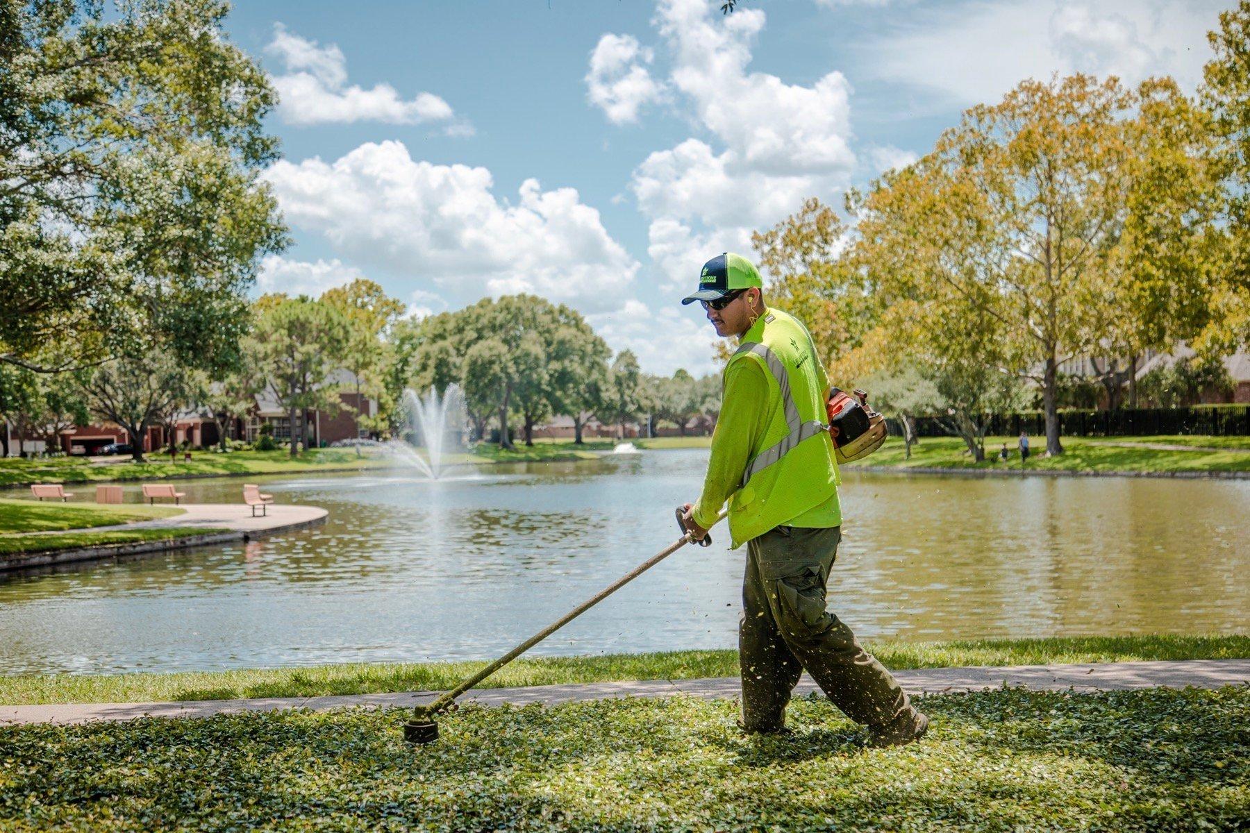 Maintenance team trimming grass