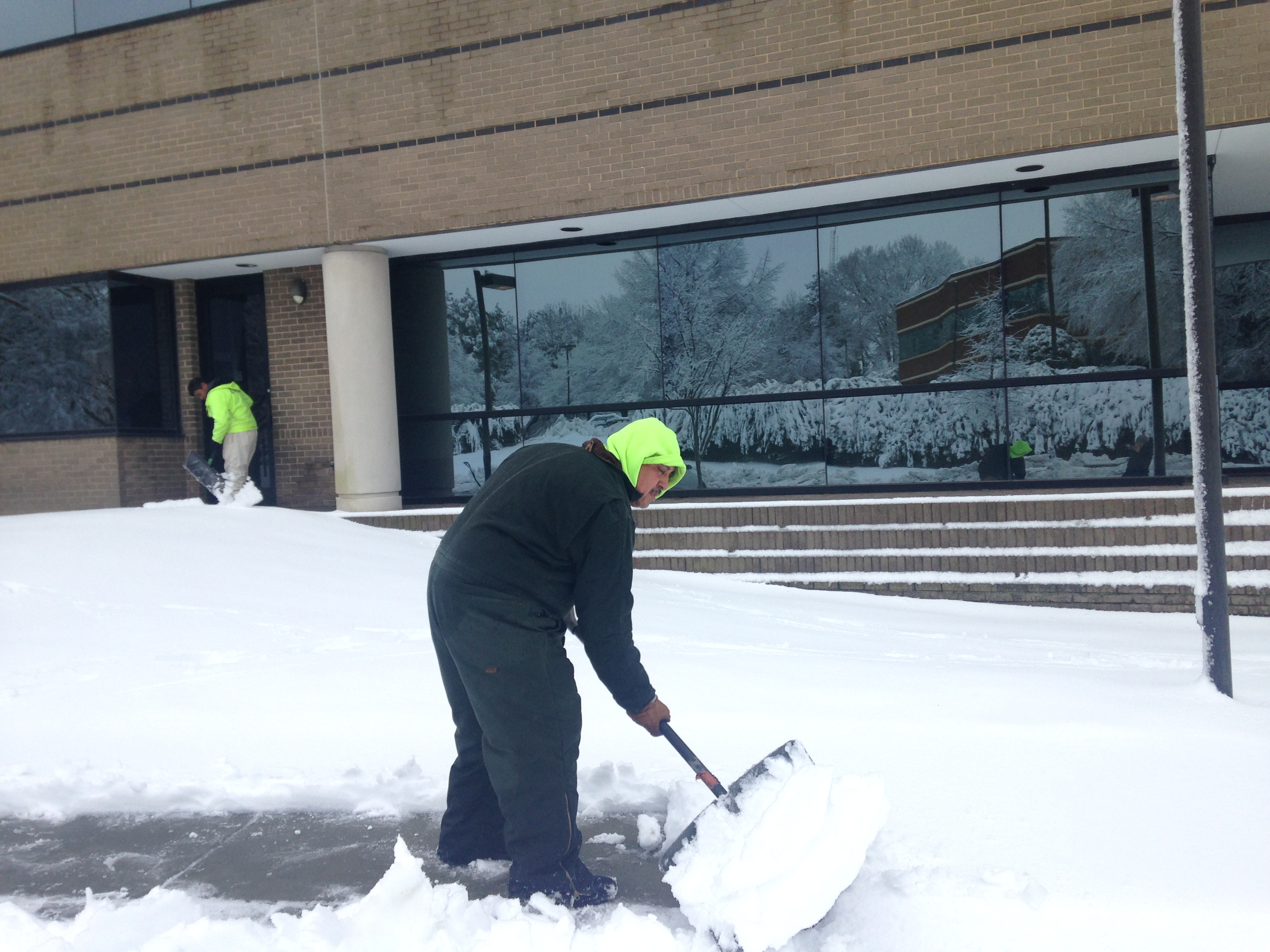 Snow and Ice management team shoveling snow