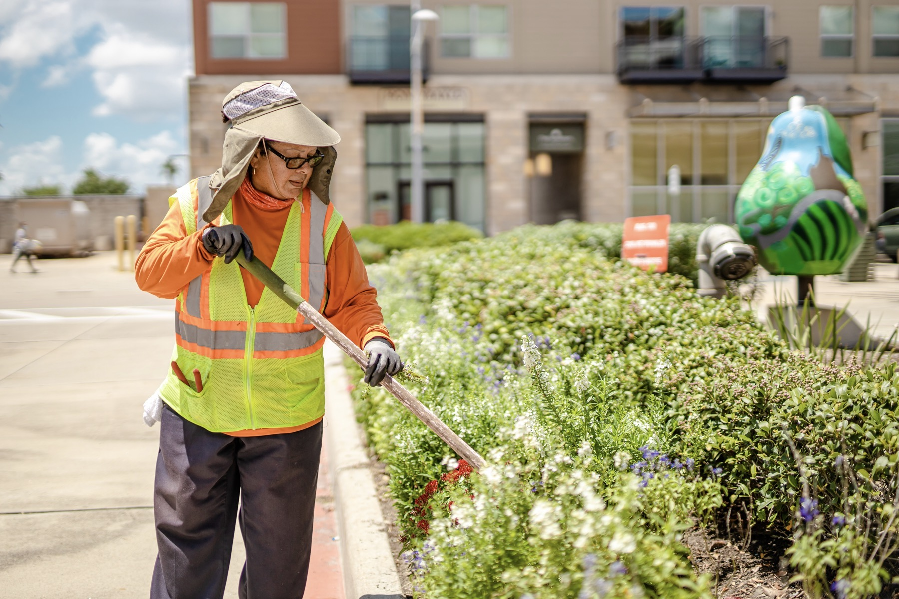 commercial landscape maintenance crew maintaining perennial bed