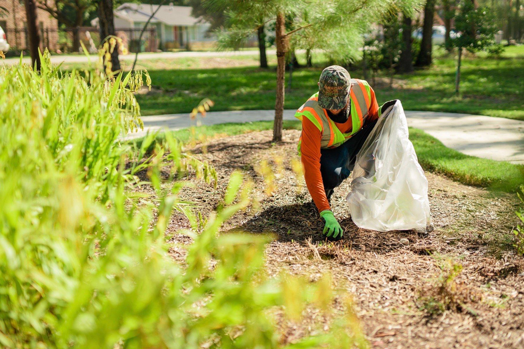 commercial landscape maintenance crew weeding