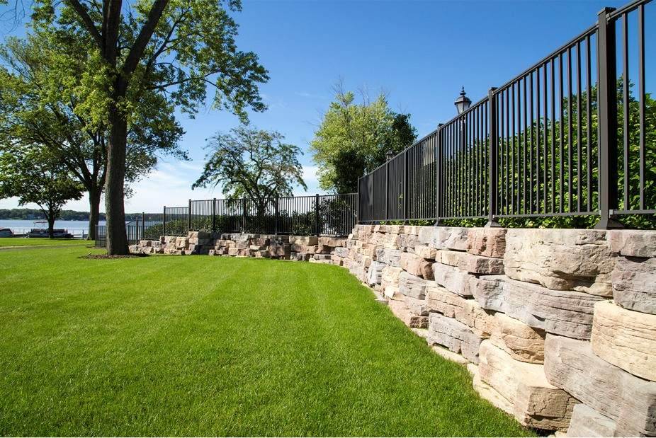 Green lawn and retaining wall