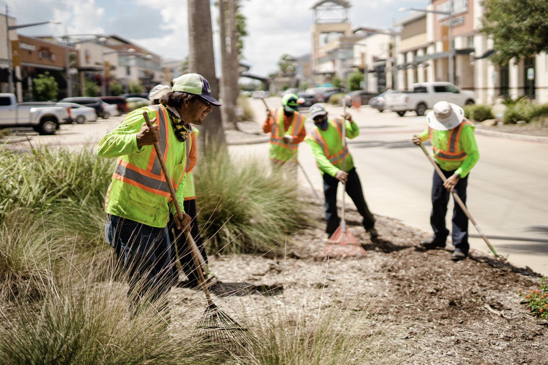 Yellowstone maintenance crew mulching a landscape bed in Dallas, TX