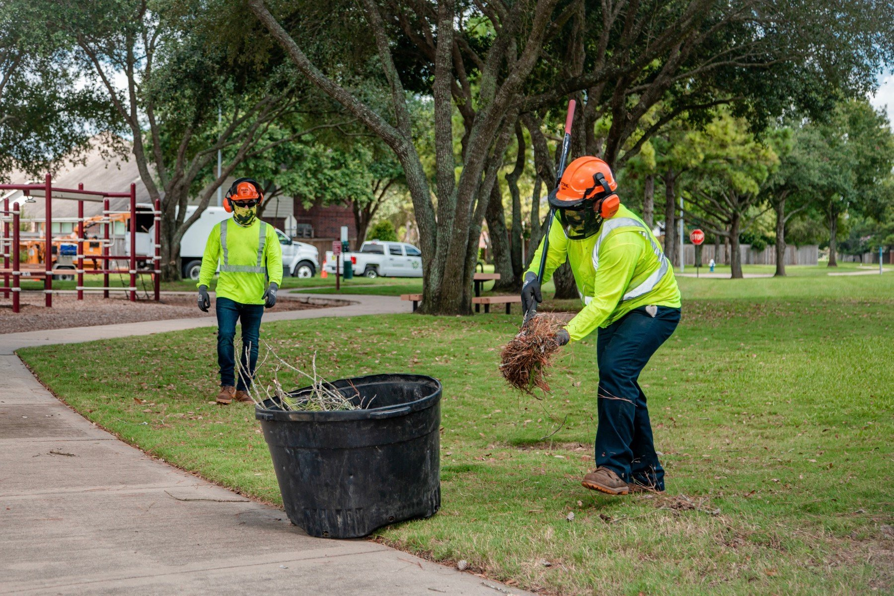 Maintenance crews cleaning up leaf and tree debris
