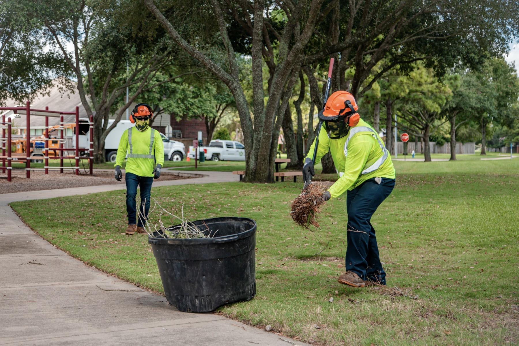 Maintenance crews cleaning up leaf and tree debris